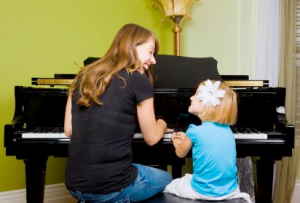 parent and child at piano